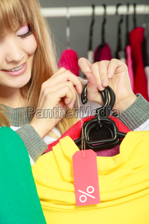 woman holding discount label sale and