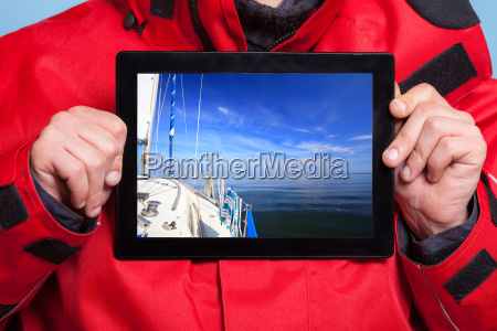 man showing yacht sailor boat on