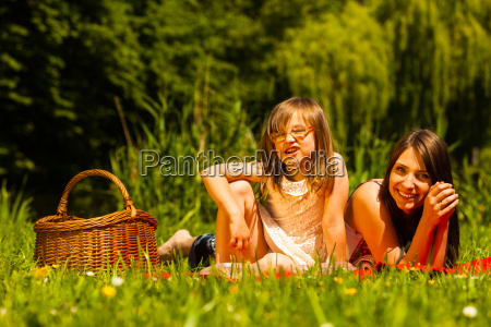 mother and daughter on picnic summer