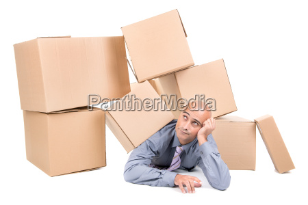 businessman under boxes