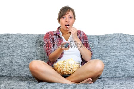 young woman eating popcorn young woman