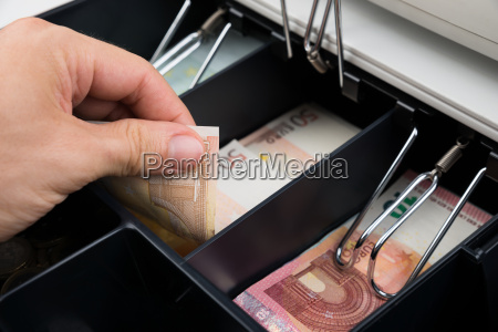 person hands with banknote in cash