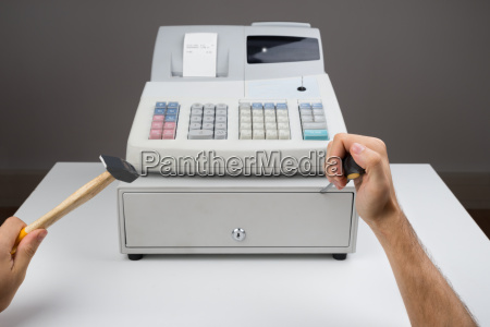 person hands with worktool and cash