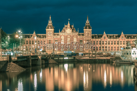 night amsterdam canal and centraal station