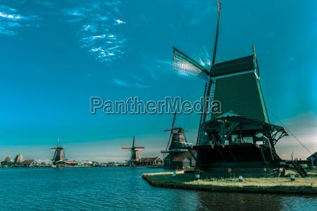windmills in zaanse schans holland netherlands