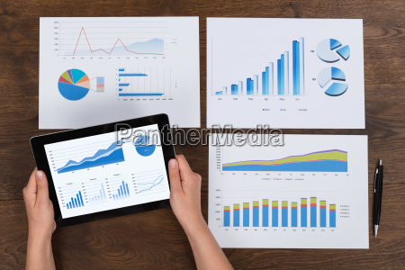 person analyzing financial charts