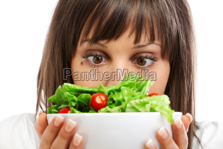 young woman preparing healhty salad young