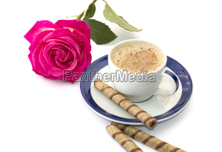 pink rose and cappuccino on a
