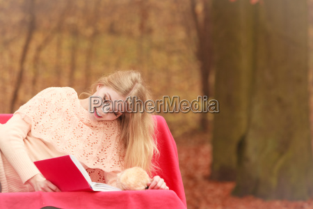 woman relaxing in autumn fall park