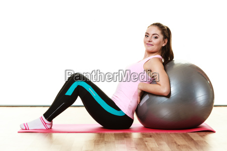 woman doing fitness exercise with fit