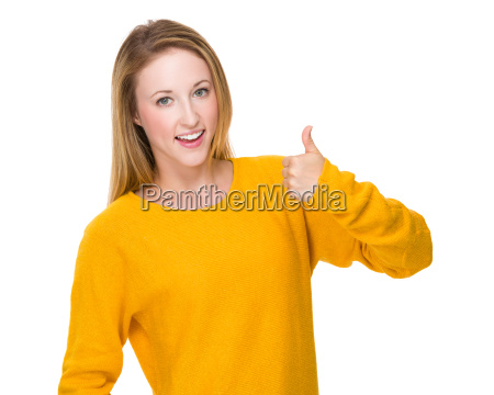 caucasian woman showing the thumb up