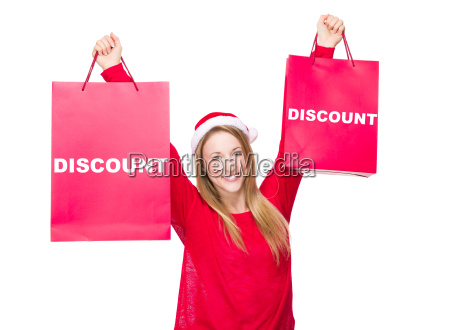 woman with christmas hat and hold