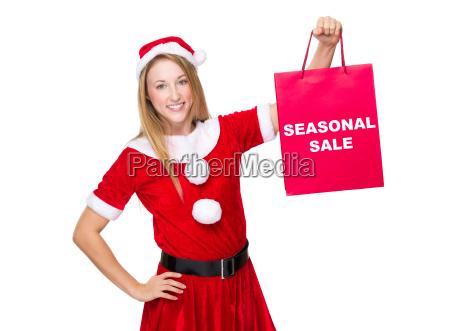xmas girl hold shopping bag with