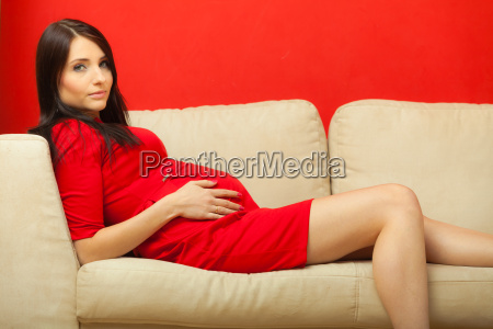 pregnant woman relaxing on a sofa