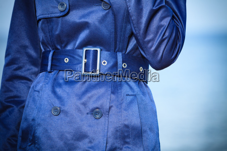 female fashion closeup blue coat wit