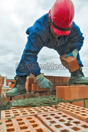 construction mason worker bricklayer under working