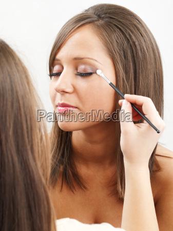 applying make up applying make up