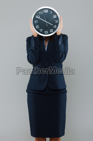 businesswoman with a clock businesswoman with