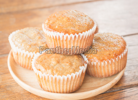 homemade banana muffins on wooden plate