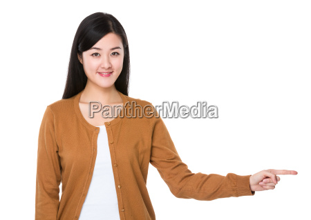 young woman with finger show aside