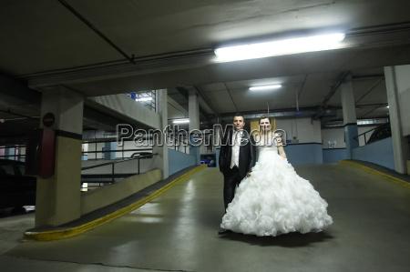 newlyweds standing in garage