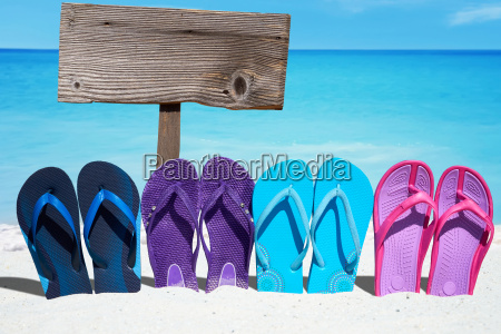 colorful flip flops and a wooden