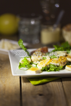 caesar salad on rustic wooden