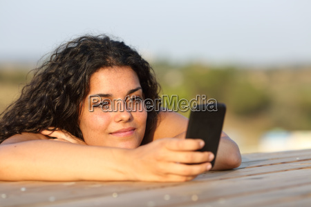 relaxed girl watching social media in