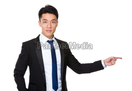 young businessman with finger point aside