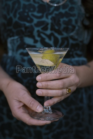 a woman holding a martini glass