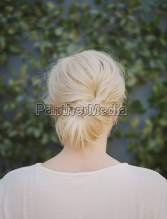 a woman with blonde hair arranged