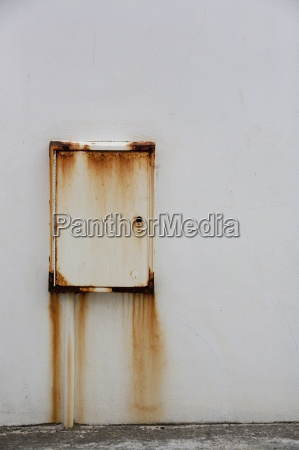 a wall mounted metal box with