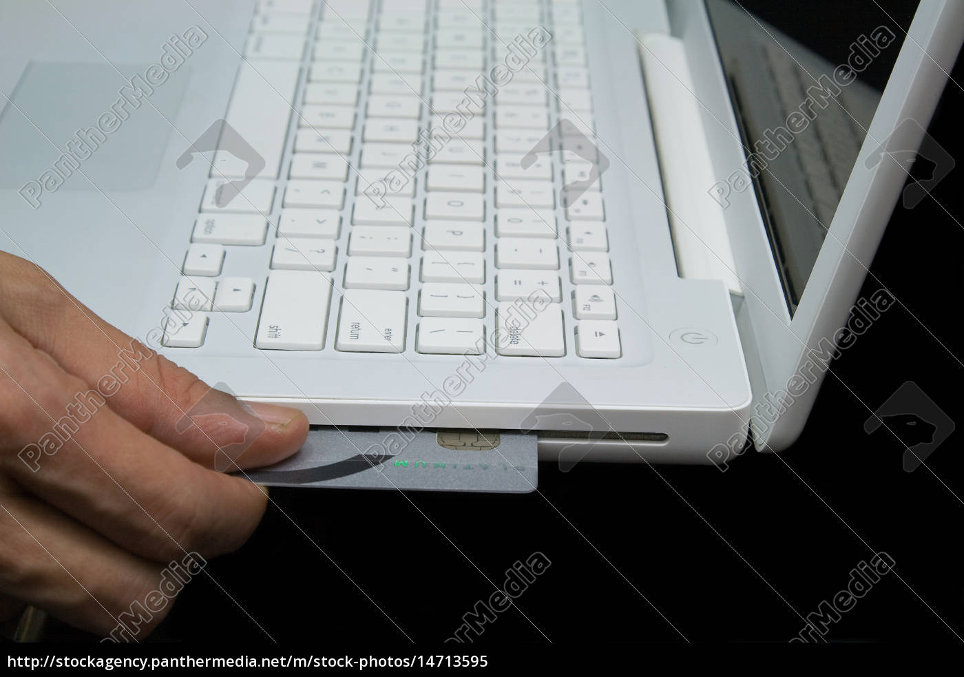 credit, card, in, white, laptop - 14713595