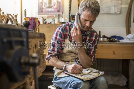 an antique furniture restorer in his