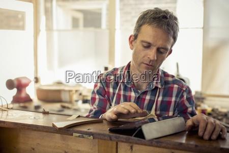 an antique furniture restorer a craftsman