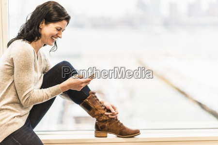 a business woman seated by a