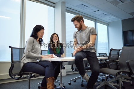 three colleagues at a meeting two
