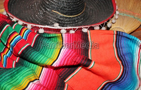 mexican sombrero fiesta poncho serape background