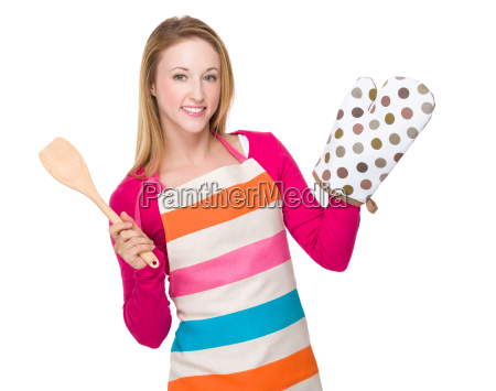 young housewife raise oven gloves and