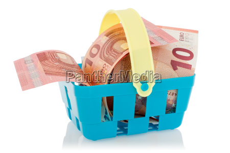 euro banknotes in shopping basket