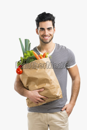 man carrying a bag full of
