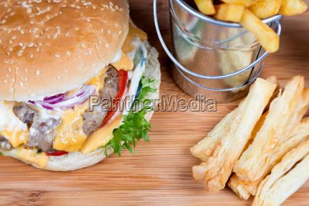 burger with fried potatos in bucket