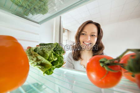 woman looking at vegetables view from