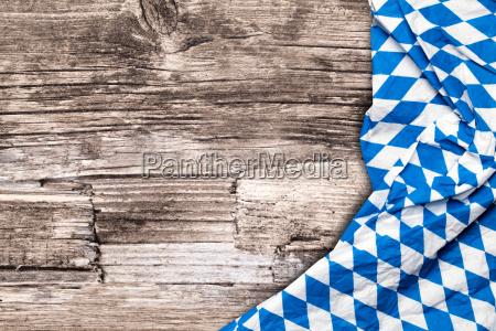 oktoberfest tablecloth on wooden table