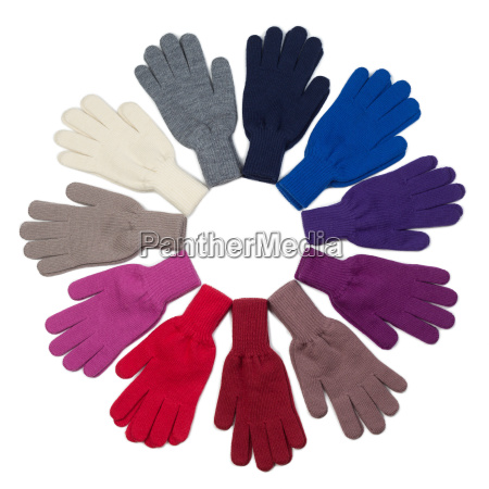 knitted gloves various colors isolated on