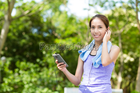 sporty woman hold with cellphone and