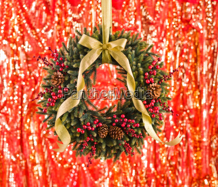 green advents wreath with autumn decoration