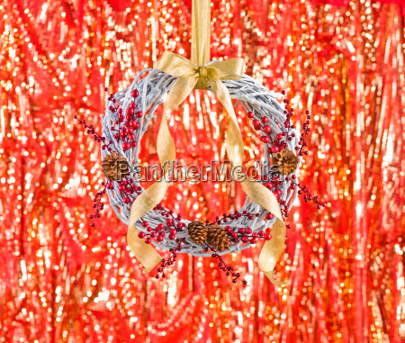 white advents wreath with golden ribbon