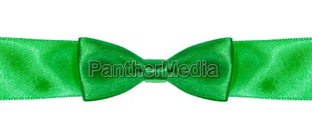 symmetric bow knot on green satin