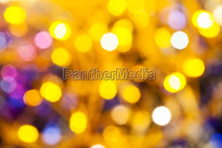 yellow pink blurred shimmering christmas lights
